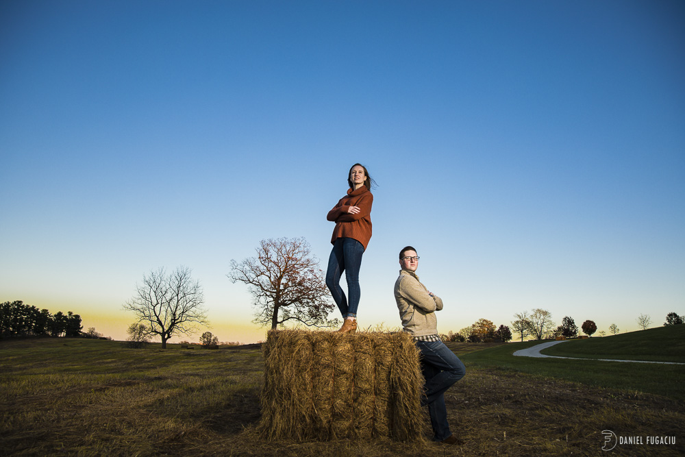 couple on hay at sunset