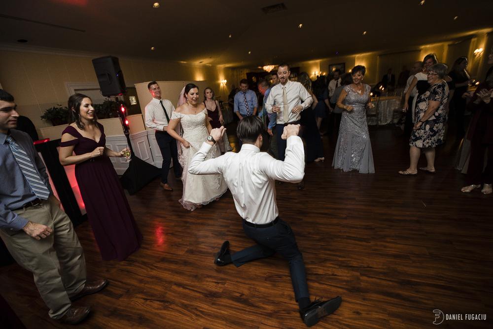 break dancing groomsmen